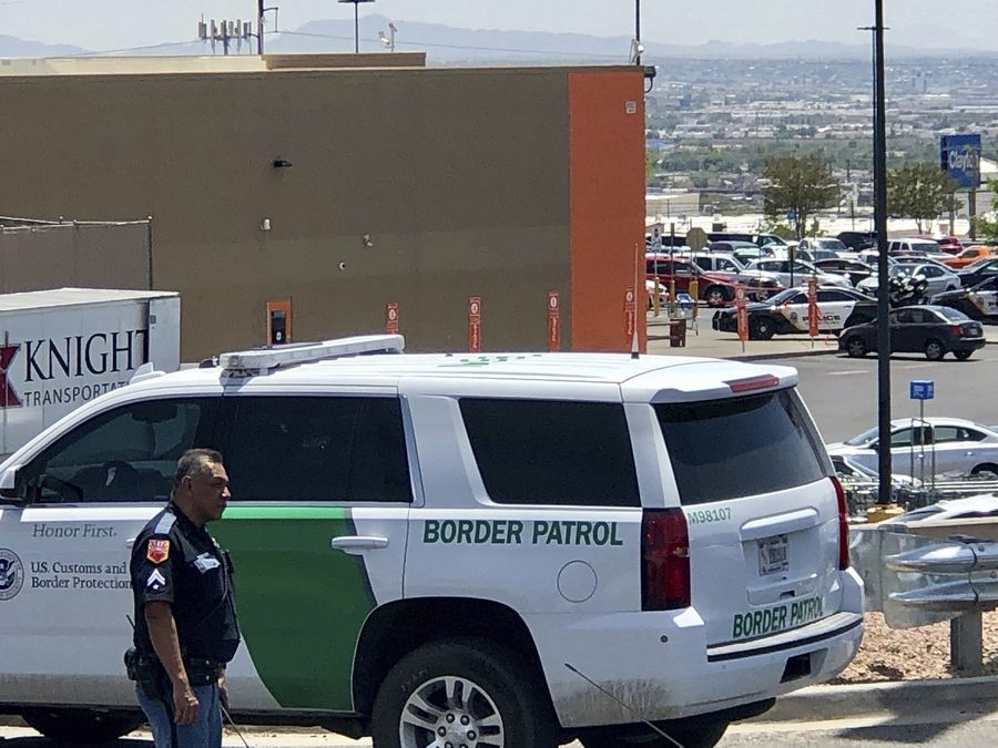 Law enforcement work the scene of a shooting at a shopping mall in El Paso, Texas, on Saturday, Aug. 3, 2019.   Multiple people were killed and one person was in custody after a shooter went on a rampage at a shopping mall, police in the Texas border town of El Paso said.
