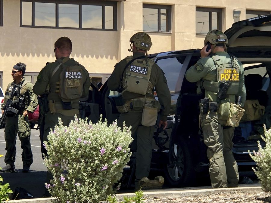 Law enforcement from different agencies work the scene of a shooting at a shopping mall in El Paso, Texas, on Saturday, Aug. 3, 2019.   Multiple people were killed and one person was in custody after a shooter went on a rampage at a shopping mall, police in the Texas border town of El Paso said.