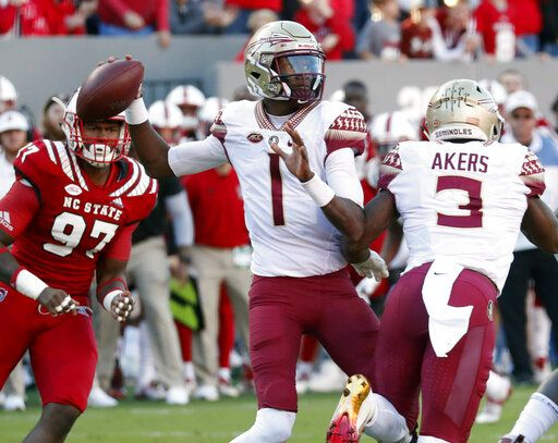 FILE - In this Nov. 3, 2018, file photo, Florida State's James Blackman (1) looks to pass during the first half of the team's NCAA college football game against North Carolina State in Raleigh, N.C. Blackman is in the driver's seat in the quarterback competition at Florida State.