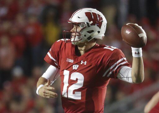 FILE - In this Oct. 6, 2018 file photo, Wisconsin's Alex Hornibrook throws during the first half of an NCAA college football game against Nebraska in Madison, Wis.  James Blackman was Florida State's starter in 2017, but Blackman acknowledges he's in an open competition with Wisconsin transfer Alex Hornibrook and others. Hornibrook completed 60 percent of his passes and led the Badgers to a 26-6 mark as their starter.