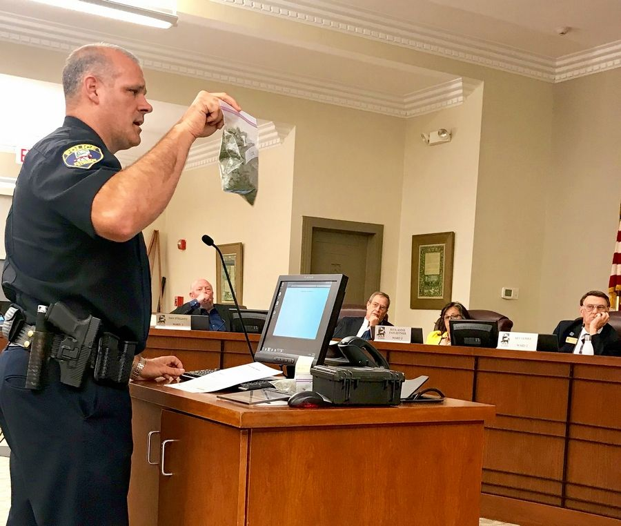 St. Charles Police Chief James Keegan demonstrates a bag resembling 30 grams of marijuana -- the legal limit for use and possession under the state's new Cannabis Regulation and Tax Act.