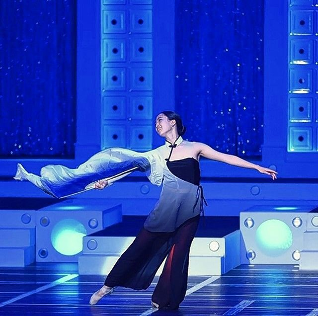 Dora Guo of Vernon Hills performs a Chinese folk dance during the Distinguished Young Woman of America national competition this summer. Dora, a Stevenson High School graduate who's headed to Yale University, won the competition.