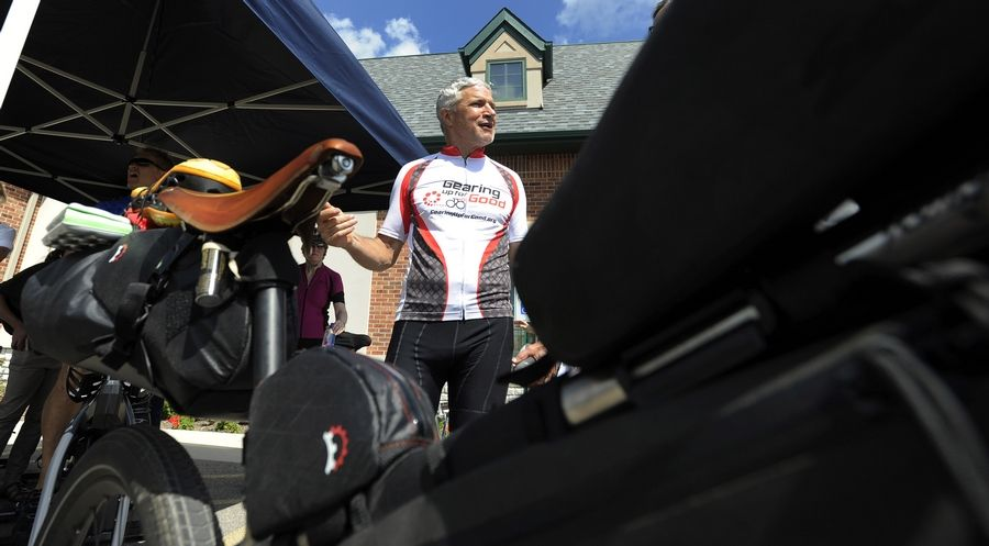 Joe Motz, 65, stopped at the NeuroBalance Center in Barrington on Wednesday during his 6,500-mile bicycle trip across the country to raise $650,000 to help those with Parkinson's disease.