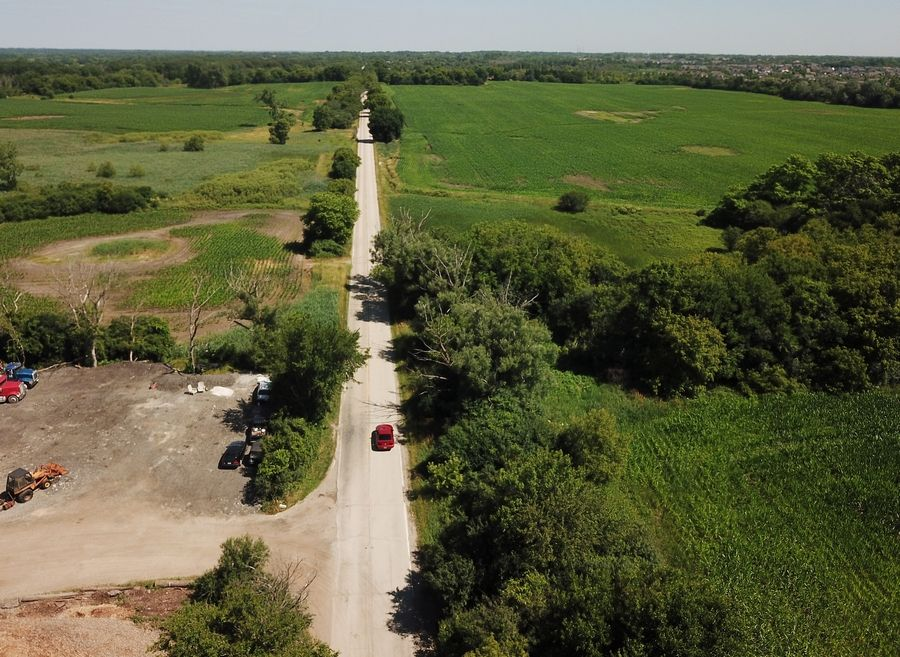 Hoffman Estates is proposing a TIF district for an area of the dormant Plum Farms development proposal at the northwest corner of routes 59 and 72. This view looks north along Old Sutton Road, just north of Higgins Road.
