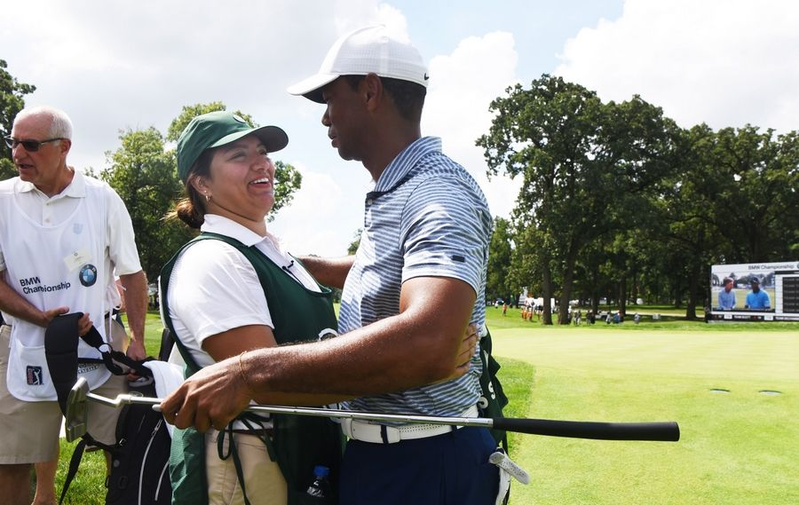 Evans Scholar caddie Sarahi Ortiz gets a hug from Tiger Woods at the conclusion of his pro-am round at Medinah Wednesday before the BMW Championship.