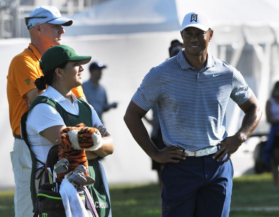 "Tiger Woods talks with Evans Scholar caddie Sarahi Ortiz and his official looper, Joe LaCava, during the BMW Championship pro-am round at Medinah Wednesday. ""We talked about what I wanted to do when I was older once I'm done with school, and he said that he really wants me to keep going and keep doing what I'm doing because he thinks I'm on the right track,"" Ortiz said."