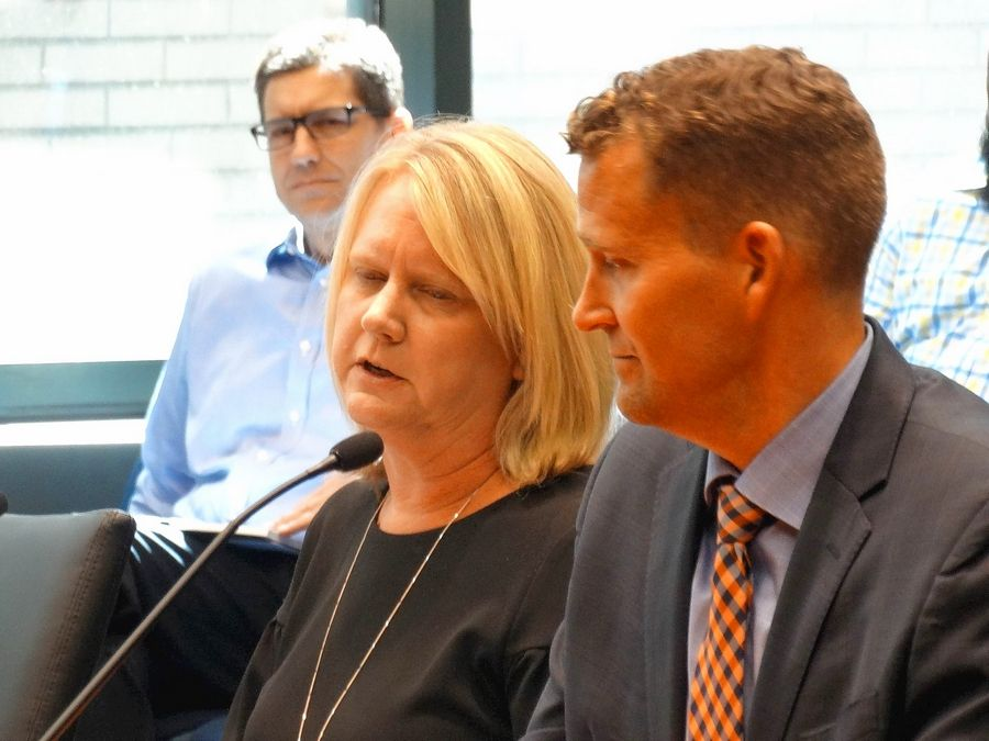 Michelle Trame, director of student financial aid at the University of Illinois, and Andy Borst, director of undergraduate admissions, answer questions from state lawmakers about the number of students from wealthy families who are obtaining need-based financial aid because their parents placed them in guardianship arrangements.