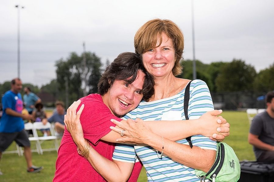NSSRA participant JC Pujals of Glenview embraces mom Catherine just after dinner at last year's Summer Bash.