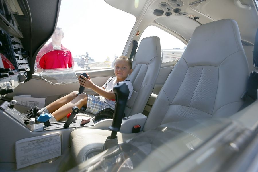 Fenian Arellano, 5, of West Chicago, feels right at home in the cockpit during the DuPage Airport celebration.