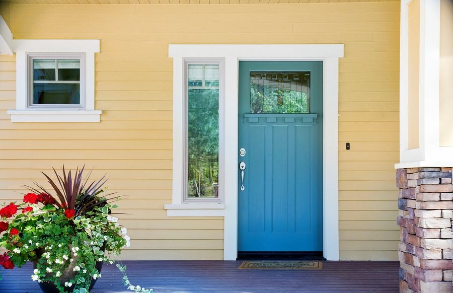 A beautiful front entrance, with either a new or freshly painted door, improves your home's curb appeal.