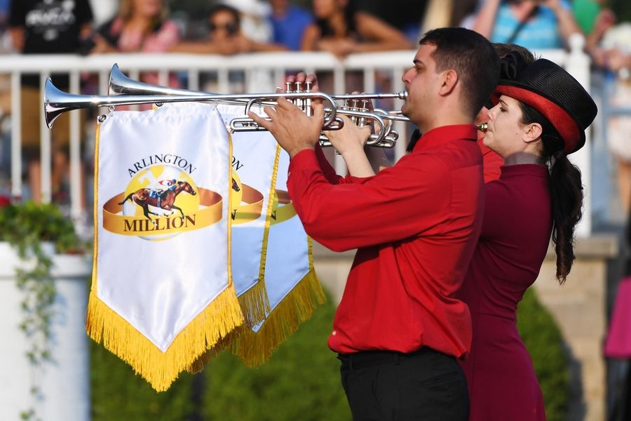 Monica Benson of Chicago leads a trio of buglers to start the Arlington Million festivities last year at Arlington International Racecourse in Arlington Heights. She is the track's official bugler.