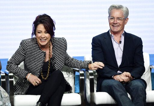"Patricia Heaton, left, and Kyle MacLachlan, cast members in the CBS series ""Carol's Second Act,"" share a laugh during the Summer 2019 Television Critics Association Press Tour at the Beverly Hilton, Thursday, Aug. 1, 2019, in Beverly Hills, Calif. (Photo by Chris Pizzello/Invision/AP)"