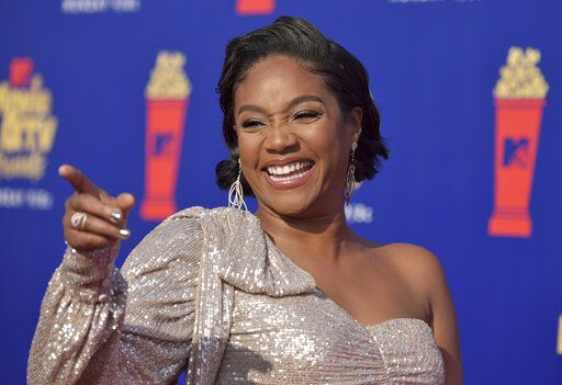 "FILE - In this June 15, 2019, file photo, Tiffany Haddish arrives at the MTV Movie and TV Awards at the Barker Hangar in Santa Monica, Calif. As a comedian, Haddish sometimes says the darndest things. Now, she's getting kids to do it, too. Haddish is host and executive producer of ABC's ""Kids Say the Darndest Things,"" the latest revival of Art Linkletter's comical interactions with children. (Photo by Richard Shotwell/Invision/AP, File)"