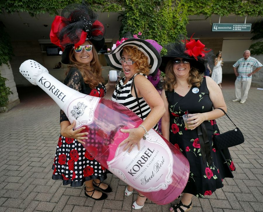 "From left, Laurie Stefanski of Racine, Wisconsin, Kirsten Erickson of Bartlett and Heather McKinnon of Madison, Wisconsin, call themselves the ""Win, Place and Show Girls"" at Arlington Park on Saturday that featured the 37th running of the Arlington Million."