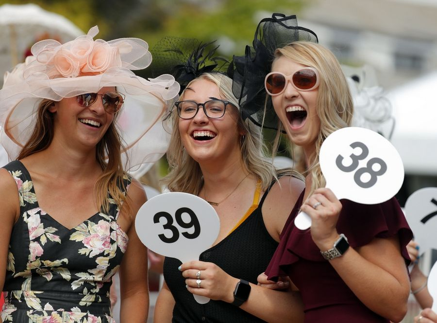 From left Jordyn Hedburg of LaCrosse, Wisconsin, Karlie Korish of Portage, Wisconsin, and Abbie Janisch also of Portage, have fun in the best-dressed contest at Arlington Park during Arlington Million Day Saturday.