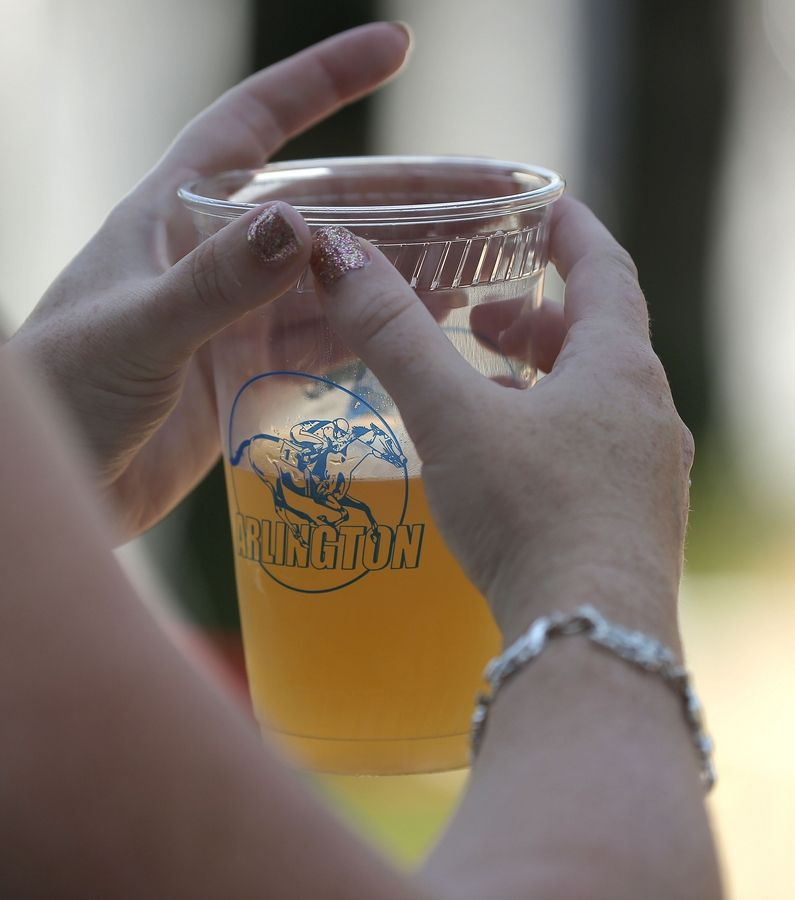 Drinks were flowing at Arlington Park as fans enjoyed the festive atmosphere Saturday for Arlington Million Day. With top-notch music, many patrons dressed to the nines and enjoyed drinks -- it looked like an amped-up yard party at the 37th running of the Arlington Million.