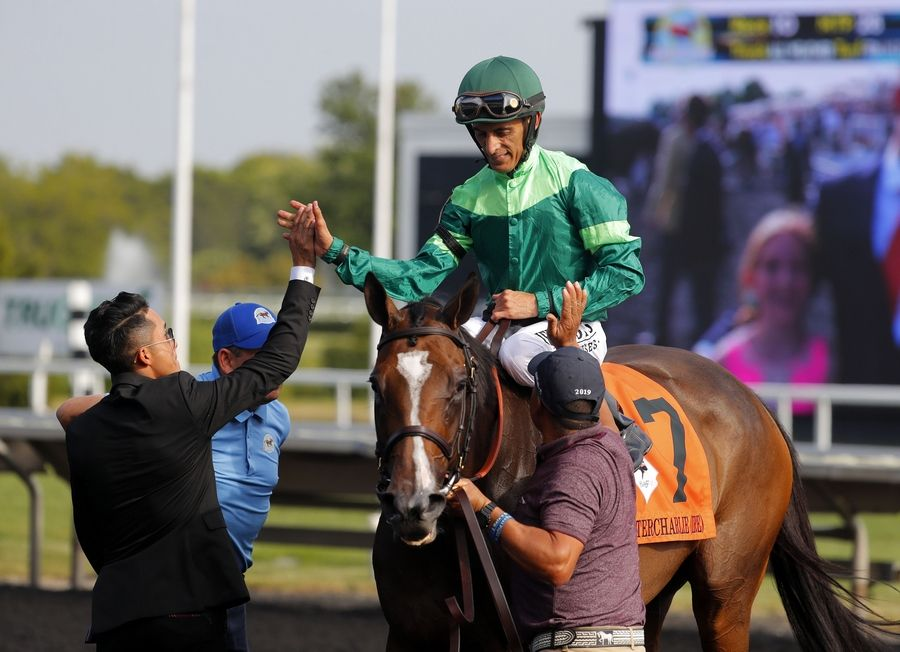 John Velazquez gets a high five after riding Sistercharlie to the win in the Beverly D at Arlington International Racecourse Saturday.