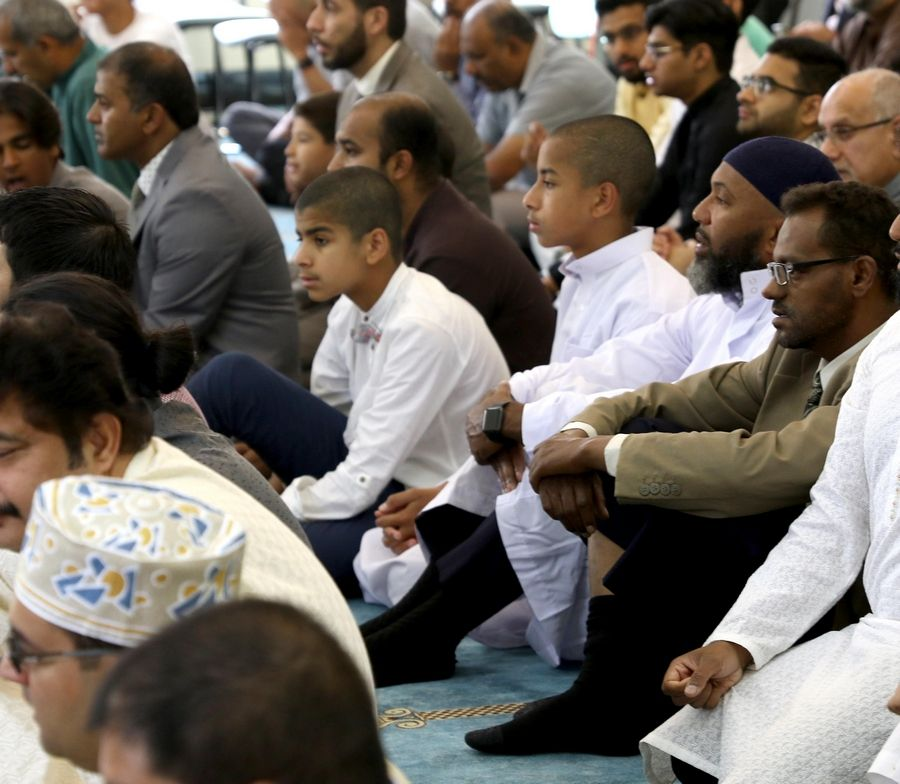 Suburban Muslims at the Islamic Foundation North in Libertyville joined millions of faithful worldwide Sunday in celebration of Eid al-Adha. Eid al-Adha commemorates the Quranic story of prophet Abraham's willingness to sacrifice his son Ismail on God's command.