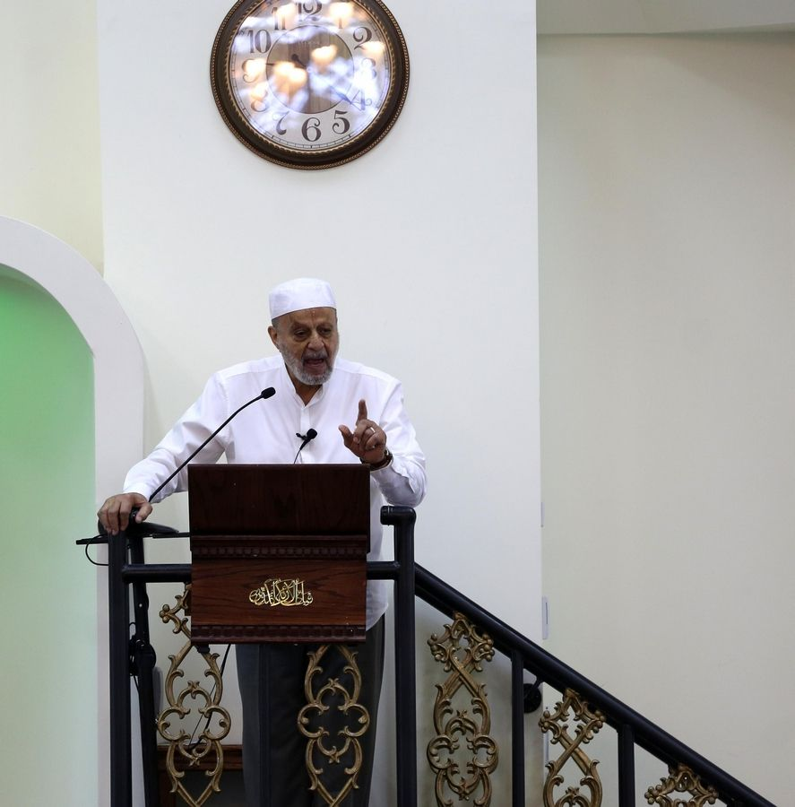 Sheikh Farid Fahmy offers a sermon Sunday morning during the celebration of Eid al-Adha at Islamic Foundation North in Libertyville.