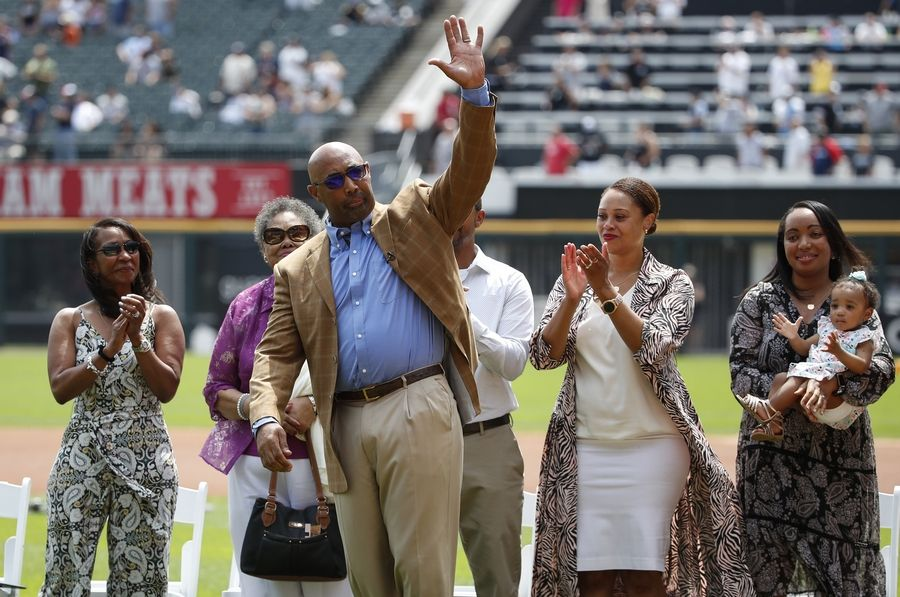 Former Chicago White Sox player Harold Baines waves to the crowd during a ceremony reflecting his Hall of Fame induction prior to a baseball game between the Chicago White Sox and Oakland Athletics, Sunday, Aug. 11, 2019, in Chicago.