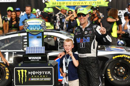 Kevin Harvick celebrates with his son, Keelan, after winning a NASCAR Cup Series auto race at Michigan International Speedway in Brooklyn, Mich., Sunday, Aug. 11, 2019.