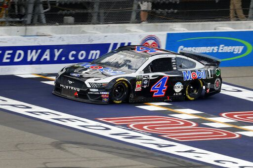 Kevin Harvick crosses the finish line to win a NASCAR Cup Series auto race at Michigan International Speedway in Brooklyn, Mich., Sunday, Aug. 11, 2019.