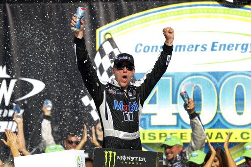 Kevin Harvick celebrates after winning a NASCAR Cup Series auto race at Michigan International Speedway in Brooklyn, Mich., Sunday, Aug. 11, 2019.