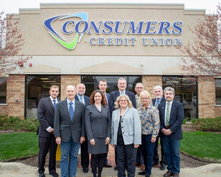 Consumer Credit Union's recently elected board of directors stands in front of the agency's Gurnee headquarters. CCU announced it will merge with Schaumburg-based Andigo Credit Union by the end of the year.
