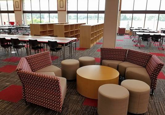 Library renovations at Bartlett, Larkin and South Elgin high schools involve reconfiguring them to incorporate new technology and more collaborative spaces. The total renovation cost for all three schools is $2.1 million. Pictured here is South Elgin's finished library.