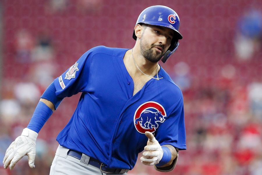 Chicago Cubs' Nicholas Castellanos runs the bases after hitting a solo home run off Cincinnati Reds starting pitcher Alex Wood during the third inning of a baseball game Thursday, Aug. 8, 2019, in Cincinnati.