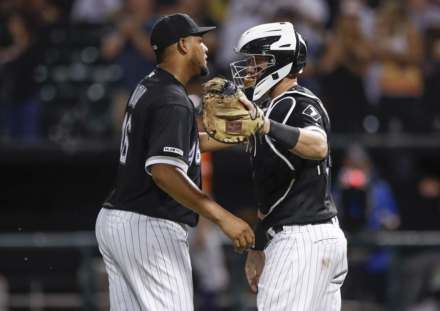Chicago White Sox's Ivan Nova, left, celebrates with James McCann, right, after the White Sox defeated the Houston Astros 4-1 in the second baseball game of a doubleheader Tuesday, Aug. 13, 2019, in Chicago.