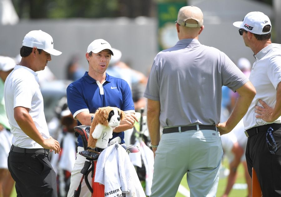 Rory McIlroy has a St. Bernard dog club cover Tuesday at the BMW Championship practice round at Medinah Country Club.
