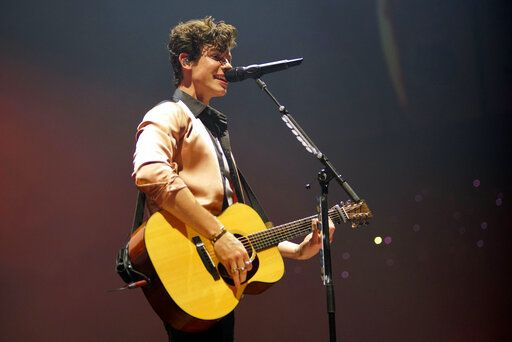 "FILE - In this June 28, 2019 file photo, Shawn Mendes performs during ""The Tour"" at the Allstate Arena in Chicago. Lil Nas X, Lizzo and Shawn Mendes are set to perform at the 2019 MTV Video Music Awards. MTV announced on Tuesday, Aug. 13, 2019  that Bad Bunny, Camila Cabello, J Balvin and Rosalia will also hit the stage at the Aug. 26 event, taking place at the Prudential Center in Newark, N.J.  (Photo by Rob Grabowski/Invision/AP, File)"