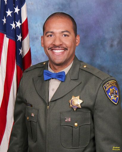 In this undated photo release by the California Highway Patrol, Officer Andre Moye Jr. A driver stopped by police pulled out a rifle and opened fire, killing Moye and wounding a few others during a shootout on a freeway overpass that left the gunman dead and sent terrified motorists running for cover. (David Earhart/Earhart Photography/California Highway Patrol via AP)