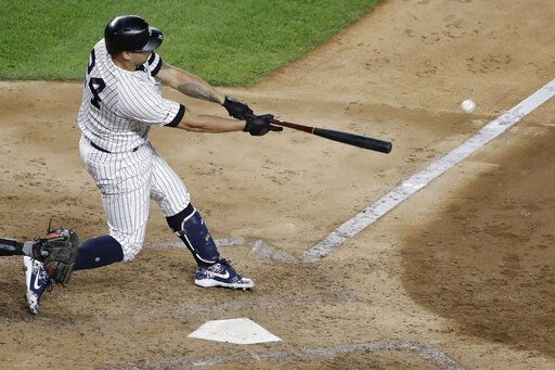 New York Yankees' Gary Sanchez follows through on a single during the sixth inning of the team's baseball game against the Baltimore Orioles on Tuesday, Aug. 13, 2019, in New York. The Yankees won 8-3.