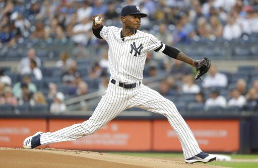New York Yankees' Domingo German delivers a pitch during the first inning of the team's baseball game against the Baltimore Orioles on Tuesday, Aug. 13, 2019, in New York.