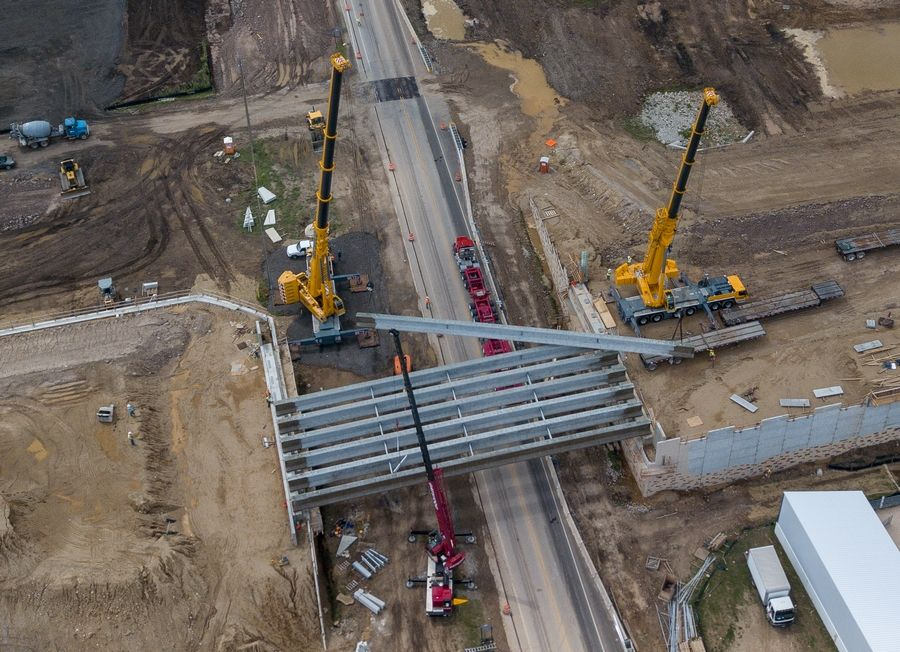 Bridge beams are installed Wednesday in Carpentersville for the construction of Longmeadow Parkway.