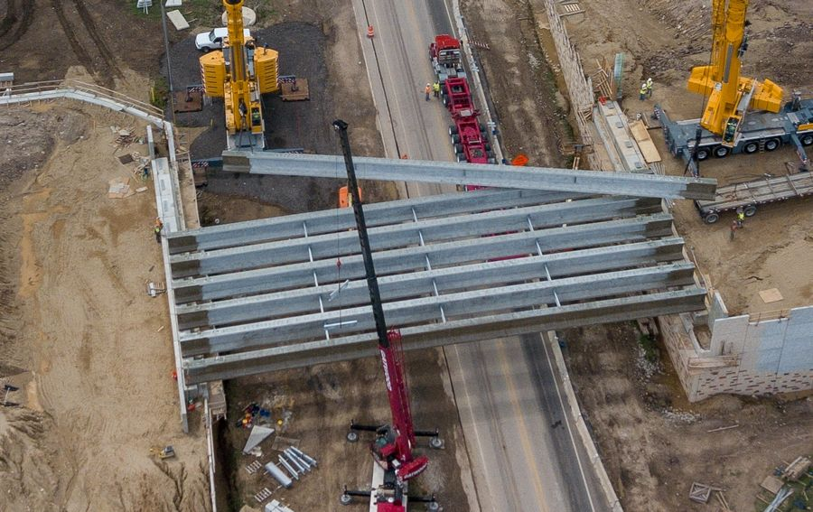 Bridge beams are installed over Route 31 as part of Kane County's project to extend Longmeadow Parkway and create a new Fox River crossing.