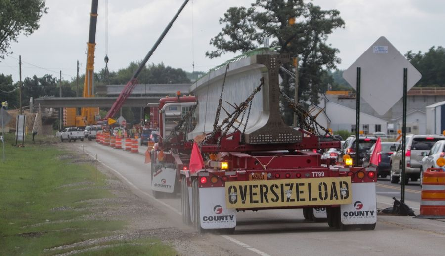 A large bridge beam arrives in Carpentersville on Wednesday as construction continues on Longmeadow Parkway.