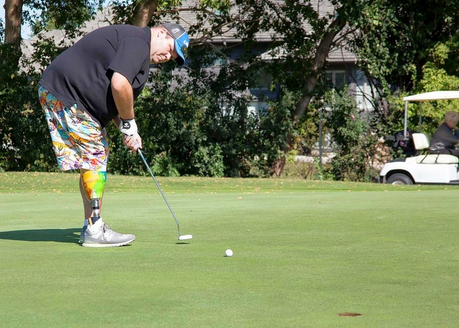 Bradley Schubert, a McHenry resident who had his right leg amputated below the knee in 2014, putts during the All Disability Open in 2018. Schubert is now the president of the Midwest Amputee Golf Association, and is encouraging all eligible golfers to participate in this year's event at Odyssey Golf Course Sept. 7 and 8.