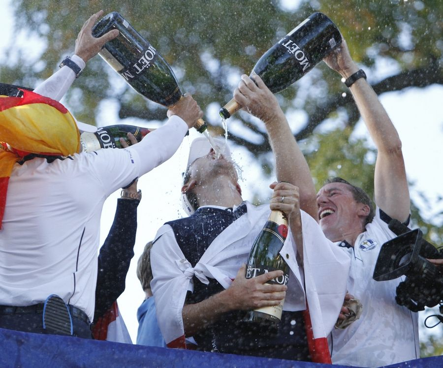 Team Europe members douse Justin Rose with champagne following their victory over the U.S. in the 2012 Ryder Cup at Medinah. Rose said as he arrived this week for the BMW Championship, all those happy memories came flooding back.
