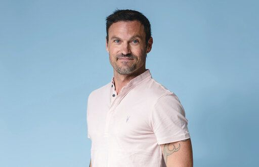 "Brian Austin Green poses for a portrait at The Associated Press on Tuesday, Aug. 13, 2019, in New York City. Green says if Tori Spelling and Jennie Garth, along with the other creators of ""BH90210,"" had approached him with a standard reboot of the 90s drama, he would've said no. (Photo by Christopher Smith/Invision/AP)"