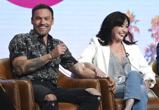 "Brian Austin Green, left, and Shannen Doherty participate in Fox's ""BH90210"" panel at the Television Critics Association Summer Press Tour on Wednesday, Aug. 7, 2019, in Beverly Hills, Calif. (Photo by Chris Pizzello/Invision/AP)"
