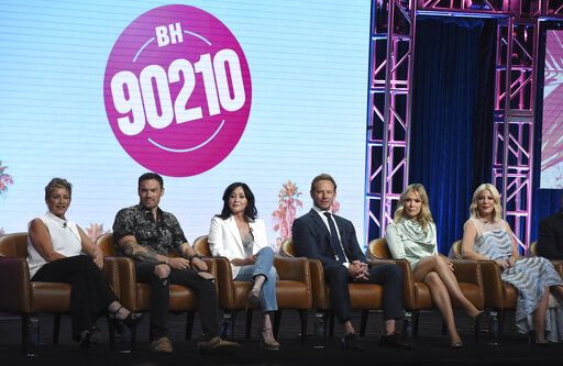"Gabrielle Carteris, from left, Brian Austin Green, Shannen Doherty, Ian Ziering, Jennie Garth and Tori Spelling participate in Fox's ""BH90210"" panel at the Television Critics Association Summer Press Tour on Wednesday, Aug. 7, 2019, in Beverly Hills, Calif. (Photo by Chris Pizzello/Invision/AP)"