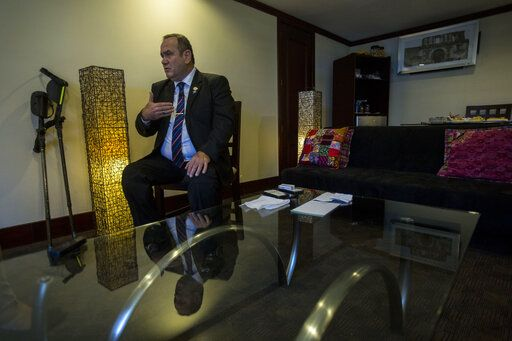 "Guatemala's President-elect Alejandro Giammattei gives an interview in Guatemala City, Tuesday, Aug. 13, 2019. Giammattei said Tuesday that his country isn't able to hold up its side of an immigration agreement with the United States or serve as a ""safe third country� for asylum seekers."