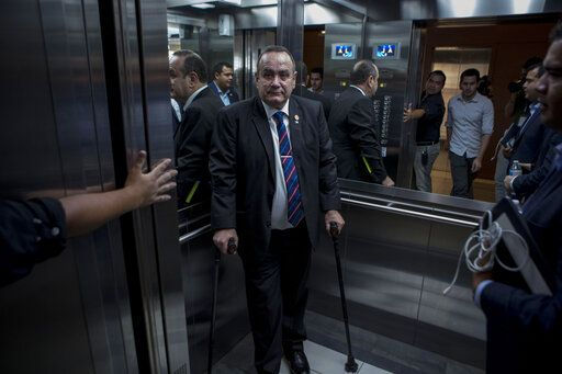 "Guatemala's President-elect Alejandro Giammattei stands in an elevator as he arrives for an interview in Guatemala City, Tuesday, Aug. 13, 2019. Giammattei said Tuesday that Guatemala will not be able to hold up its side of an immigration agreement with the United States by serving as a ""safe third country� for asylum seekers."