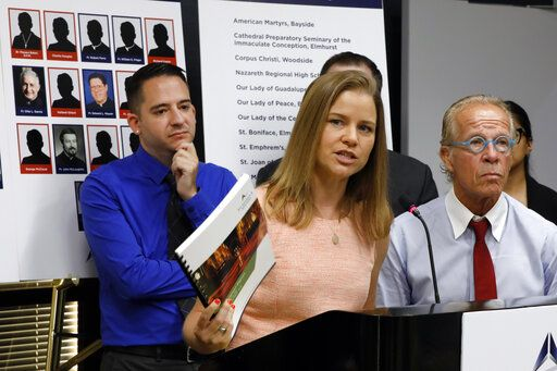 Sexual abuse victim Bridie Farrell addresses a news conference, in New York, Wednesday, Aug. 14, 2019, as fellow abuse victim Joseph Caramanno, left, and attorney Jeff Anderson listen. Wednesday marked the start of a one-year litigation window in New York allowing people to file civil lawsuits that had previously been barred by the state's statute of limitations, which was one of the nation's most restrictive before lawmakers relaxed it this year.