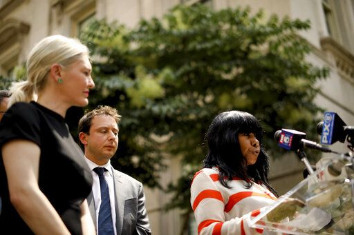 Auset Love, right, speaks at a news conference outside the New York City Department of Education headquarters on Wednesday, Aug. 14, 2019 in New York. Following the implementation of the New York Child Victims Act, Love filed a lawsuit alleging she was physically and sexually abused by a teacher in New York City starting at the age of nine.