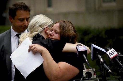 Joanne Schoonmaker, right, is consoled by her attorney Sarah Klein at a news conference outside the New York City Department of Education headquarters on Wednesday, Aug.14, 2019 in New York. Following the implementation of the New York Child Victims Act, Schoonmaker filed a lawsuit alleging she was raped by a janitor at Wellsville Middle School in Wellsville, N.Y. starting at the age of 12.