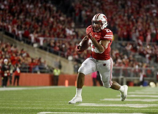 FILE - In this Oct. 6, 2018, file photo, Wisconsin's Jonathan Taylor runs for a touchdown during the second half of an NCAA college football game against Nebraska, in Madison, Wis. College football's race for its top individual awards this season will have a couple of standout players seeking repeats. Wisconsin's Jonathan Taylor won the Doak Walker Award as the nation's top running back last season, while Alabama's Jerry Jeudy earned the Fred Biletnikoff Award as college football's most outstanding receiver. Both players are back for their junior seasons.